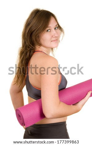 young woman looking back with mat for sport - stock photo