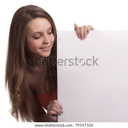 young woman looking down a white sign - stock photo