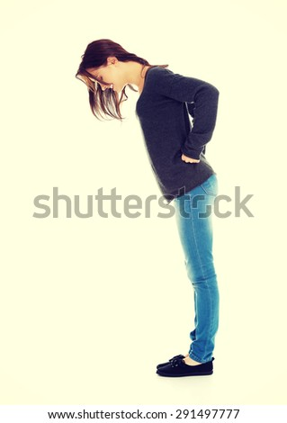 Young woman looking down on the floor - stock photo