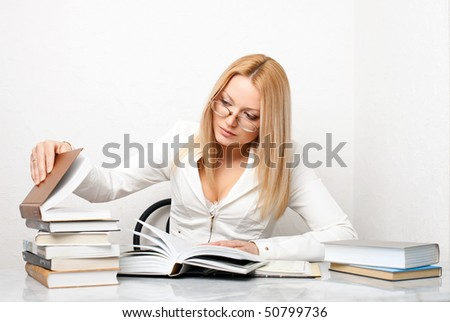 Young woman looking for some information in books, educational concept - stock photo