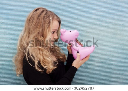 Young woman looking into her savings; where did all the money go? - stock photo