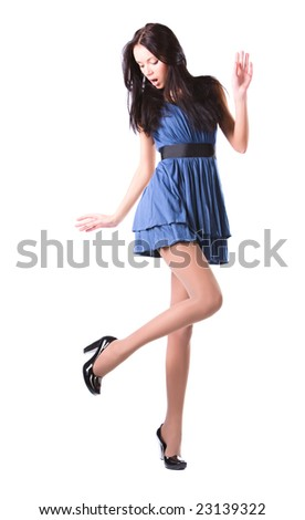 Young woman looking on her shoes. Isolated on white. - stock photo