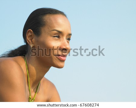 Young woman looking out over surroundings - stock photo