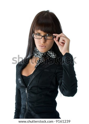 Young  woman looking over her glasses - stock photo