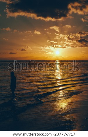 Young Woman Looking Sunset on the Beach - stock photo