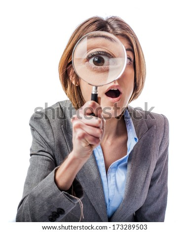 young woman looking through a magnifying glass isolated on white - stock photo