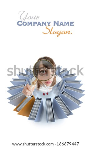 Young woman looking through a magnifying glass surrounded by office folders - stock photo