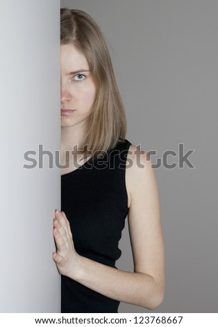Young  woman looking with reproof - stock photo
