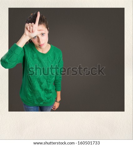 young woman loser gesture - stock photo