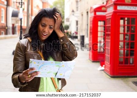 young woman lost in london - stock photo