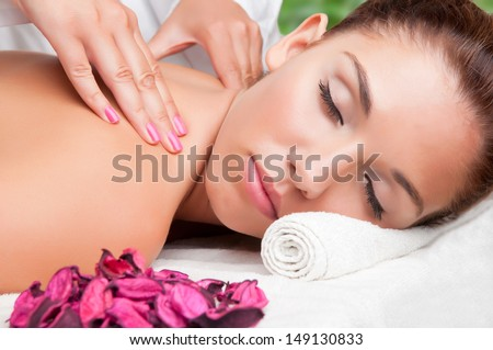 Young woman lying in a spa ready to get a massage - stock photo