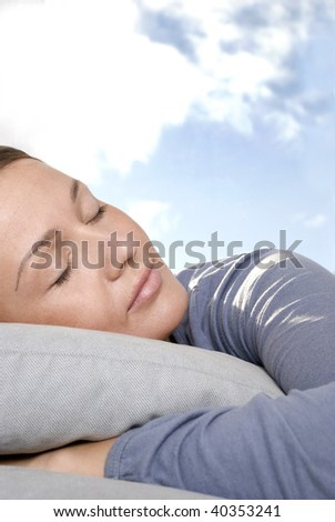 Young woman lying in living room - stock photo