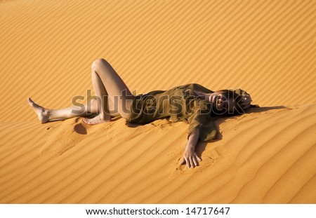 Young woman lying in the dune - stock photo