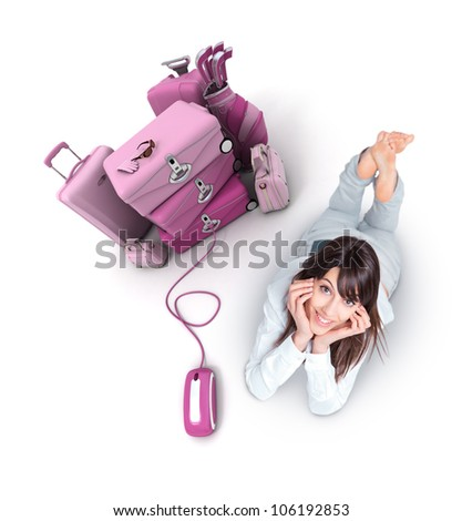 Young woman lying on the floor by a pile of luggage connected to a computer mouse - stock photo