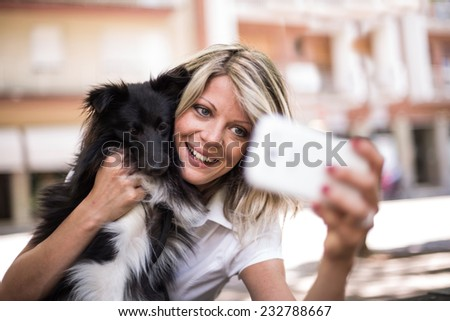 Young woman making a selfie with her dog - stock photo
