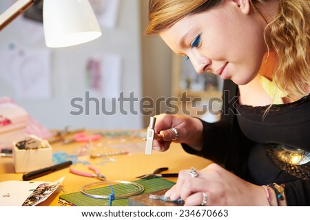 Young Woman Making Jewelry At Home - stock photo