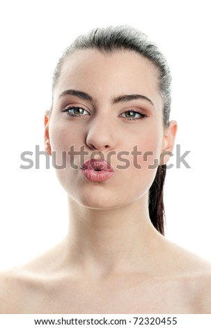 young woman making kissing expression - stock photo