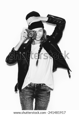 Young woman making photo using noname retro camera. black white portrait on White background not isolated - stock photo