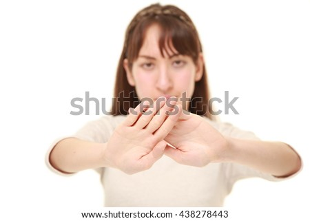 young woman making stop gesture - stock photo