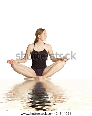 Young woman making yoga- exercises - stock photo