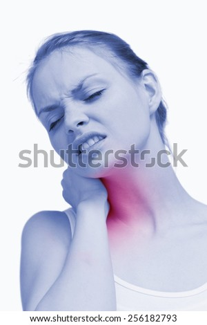 Young woman massaging her painful nape against white background - stock photo