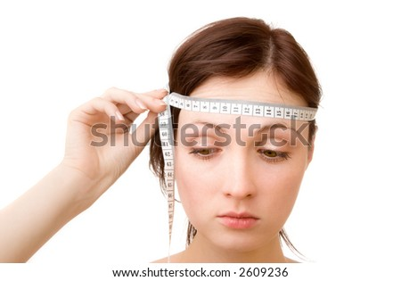 Young woman - measuring brain size (isolated on white) - stock photo