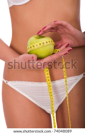 Young woman measuring her waist, isolated on white background - stock photo