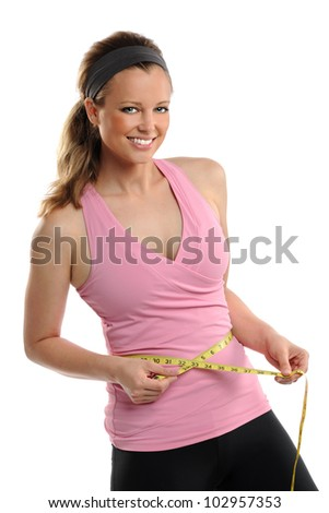 Young woman measuring waist with tape isolated over white background - stock photo