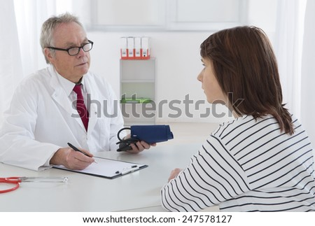 young woman medical consultation - stock photo