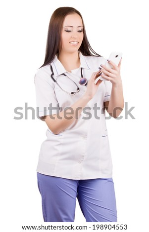 Young woman medical doctor with mobile phone. Isolated on white background. - stock photo