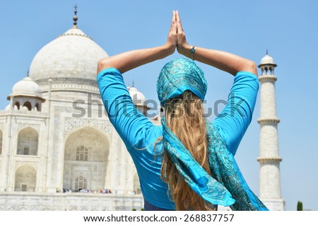 Young woman meditating at Taj Mahal. Agra, India - stock photo