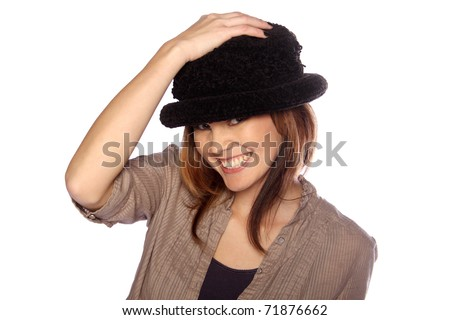 Young woman modeling her hat - stock photo