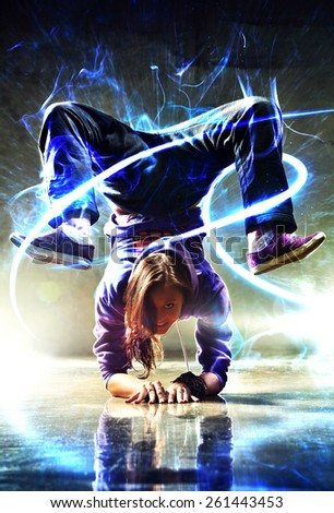 Young woman modern dancer. With lights and glow energy effect. - stock photo