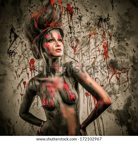 Young woman muse with creative body art and hairdo  - stock photo