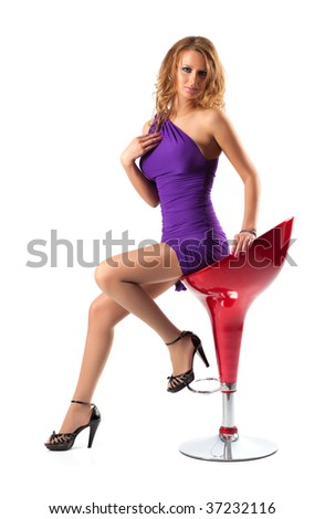Young woman on a chair. Isolated on white. - stock photo