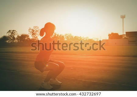 Young woman  on a running track  Female jogging. Woman jogging on sunset. Fitness health - stock photo