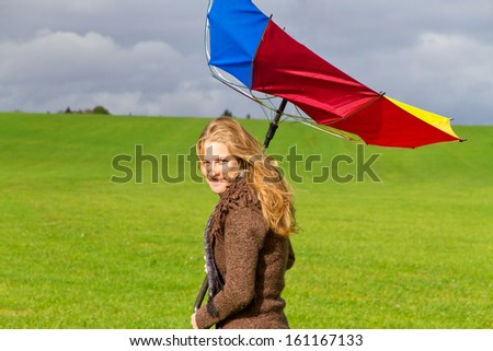 Young woman on a windy day - stock photo