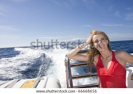 young woman on a yacht 2 - stock photo