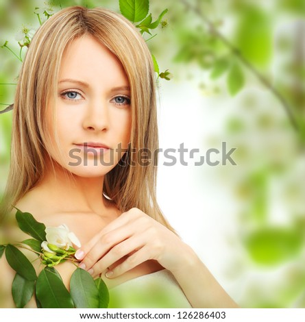 Young woman on blossom background - stock photo