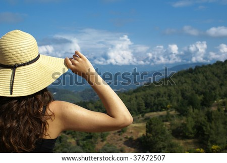 Young woman on edge . Landscape view - stock photo