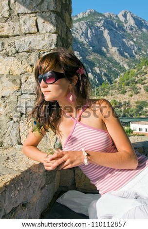 Young woman on holidays on resort of Turkey on derrick superstructure - stock photo
