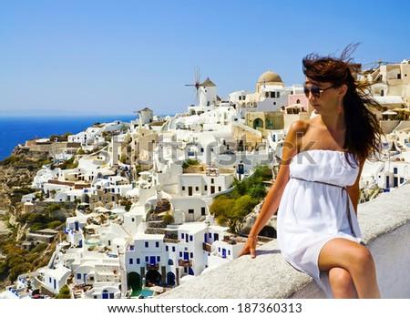 Young woman on holidays, Santorini Oia town  - stock photo