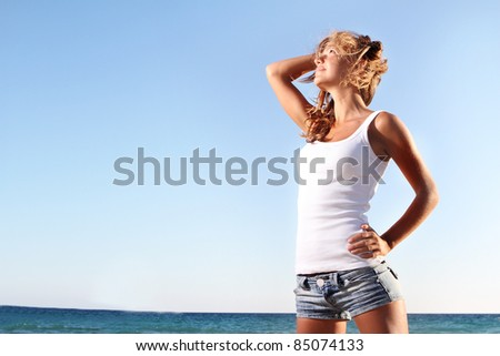 young woman on natural background - stock photo