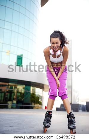Young woman on rollerblades in the city - stock photo