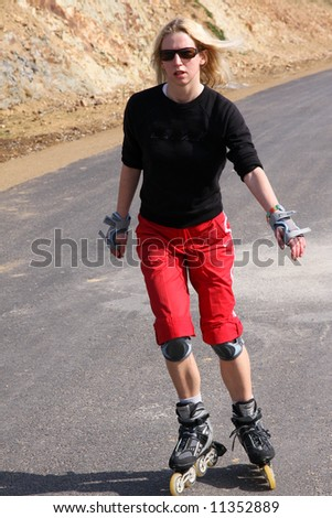 young woman on rollerskates - stock photo