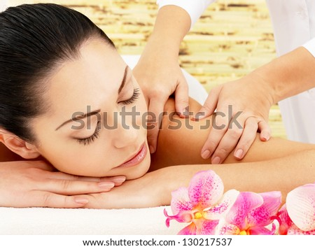 Young woman on spa massage of shoulder in the beauty salon. - stock photo