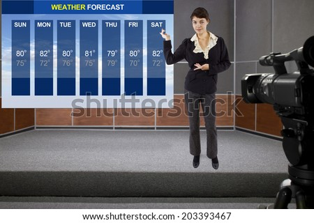 young woman on stage with weather chart and camera - stock photo