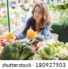 Young woman on the market - stock photo