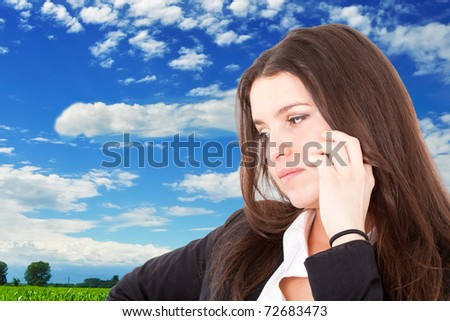 Young woman on the phone outdoor - stock photo