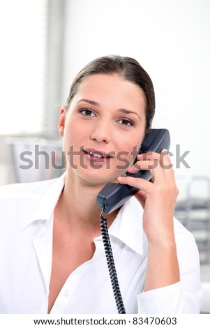 Young woman on the telephone - stock photo